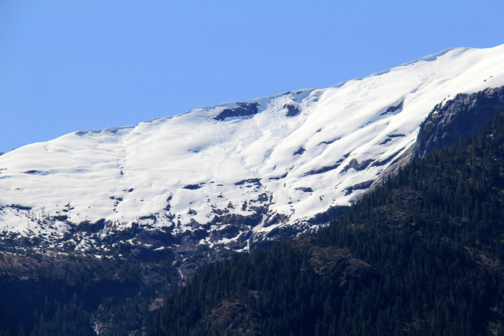 Small avalanches visible in the snow