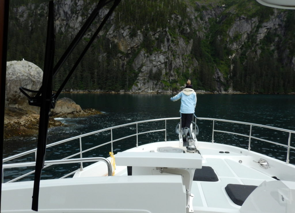 Henriette watching out for shallow rocks at the narrow entrance of Taz Cove