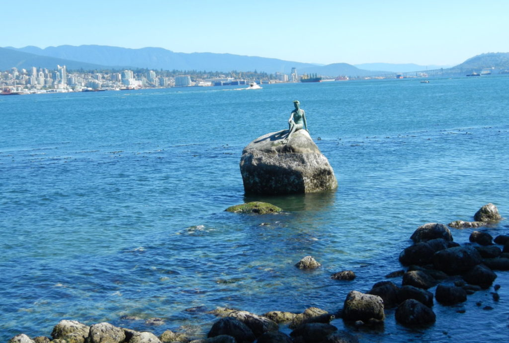 Sitting peacefully on a rock visible from the Stanley Park seawall, Girl in a Wetsuit is an iconic figure in Stanley Park.
